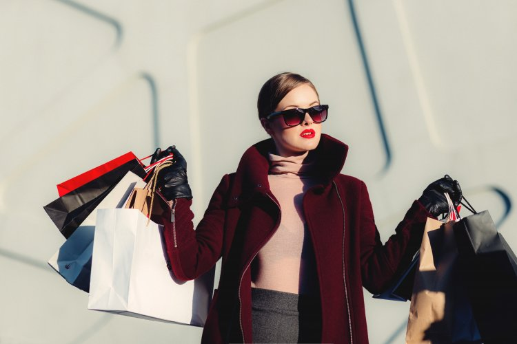 well-dressed person in sunglasses after a shopping spree