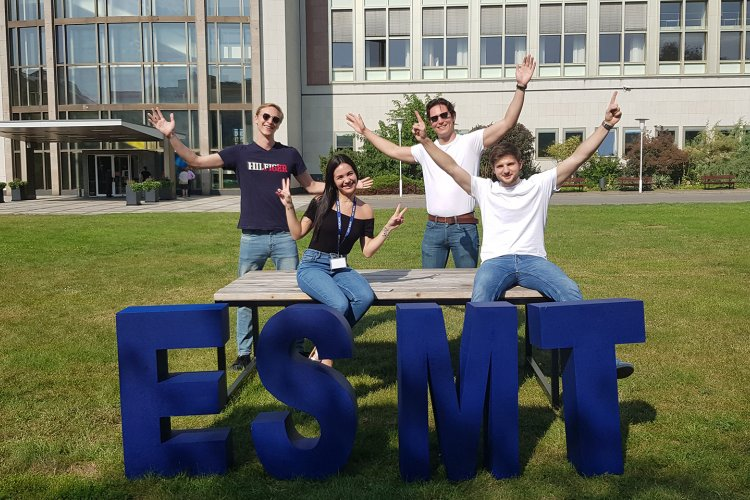 MIM students int he garden with ESMT letters