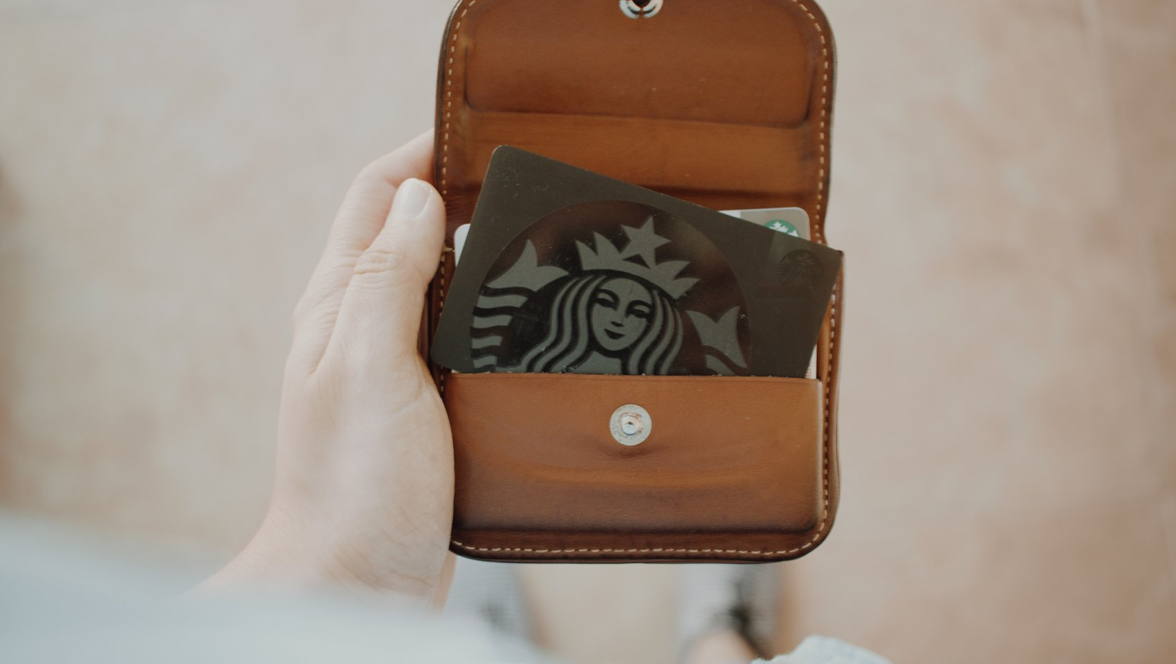 wallet with a Starbucks loyalty card