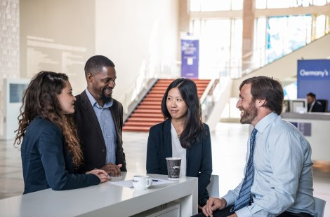 MBA students talking in the foyer